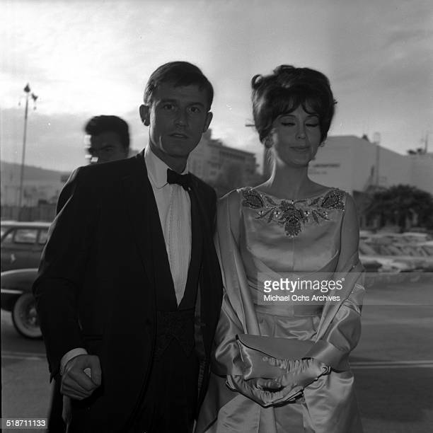 Roddy McDowall and guest arrive to an event in Los AngelesCA