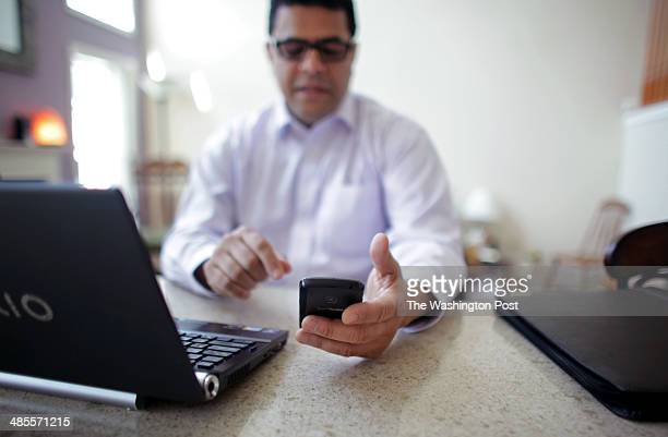 Roddy Negron checks a phone call while participating in a Resume Essentials webinar at his home on April 14 2014 Negron was laid off from Sony in...