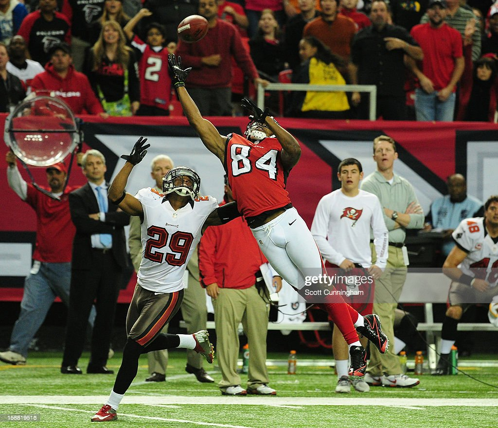 <a gi-track='captionPersonalityLinkClicked' href=/galleries/search?phrase=Roddy+White&family=editorial&specificpeople=750386 ng-click='$event.stopPropagation()'>Roddy White</a> #84 of the Atlanta Falcons goes up for a catch against Leonard Johnson #29 of the Tampa Bay Buccaneers at the Georgia Dome on December 30, 2012 in Atlanta, Georgia