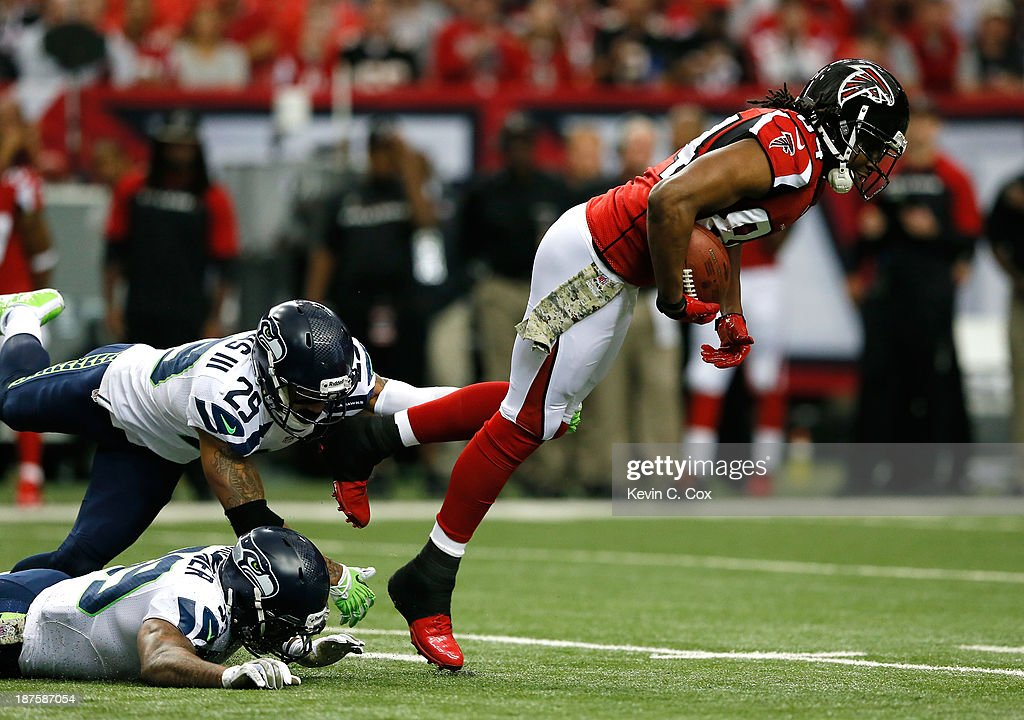 <a gi-track='captionPersonalityLinkClicked' href=/galleries/search?phrase=Roddy+White&family=editorial&specificpeople=750386 ng-click='$event.stopPropagation()'>Roddy White</a> #84 of the Atlanta Falcons is tackled by <a gi-track='captionPersonalityLinkClicked' href=/galleries/search?phrase=Brandon+Browner&family=editorial&specificpeople=749482 ng-click='$event.stopPropagation()'>Brandon Browner</a> #39 and Earl Thomas #29 of the Seattle Seahawks at Georgia Dome on November 10, 2013 in Atlanta, Georgia.