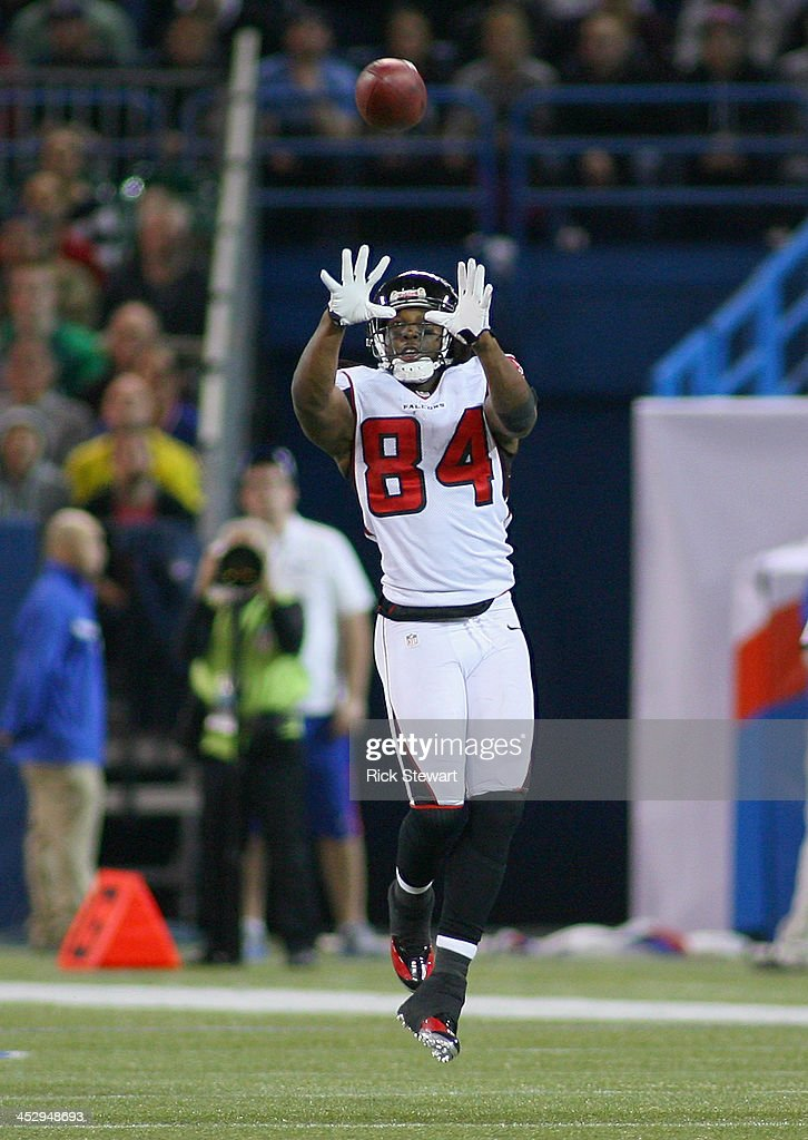 Roddy White #84 of the Atlanta Falcons makes a catch against the Buffalo Bills at Rogers Centre on December 1, 2013 in Toronto, Ontario.Atlanta won 34-31 in overtime.