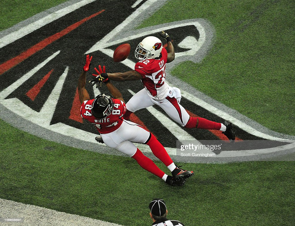Roddy White #84 of the Atlanta Falcons makes a catch against William Gay #22 of the Arizona Cardinals at the Georgia Dome on November 18, 2012 in Atlanta, Georgia White was ruled out of bounds on the play.
