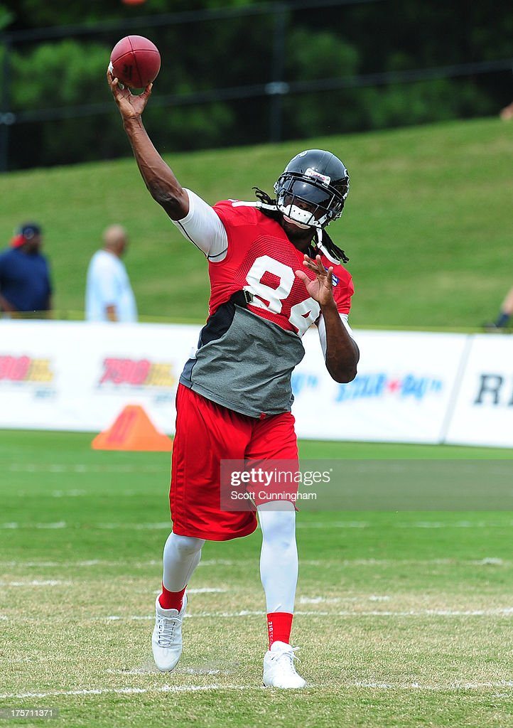 Roddy White #84 of the Atlanta Falcons passes during practice against the Cincinnati Bengals at the Atlanta Falcons Training Complex on August 6 2013 in Flowery Branch, Georgia.