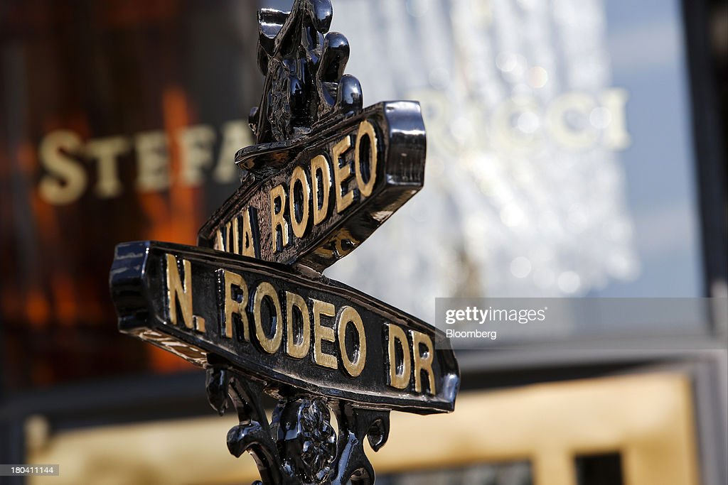 A Rodeo Drive street sign stands in Beverly Hills, California, U.S., on Wednesday, Sept. 11, 2013. The U.S. Census Bureau is scheduled to release retail sales figures on Sept. 13. Photographer: Patrick T. Fallon/Bloomberg via Getty Images