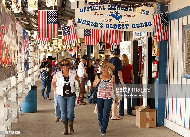 Rodeo goers arrive to the Prescott Frontier Days 'World's Oldest Rodeo' on July 4 2014 in Prescott Arizona