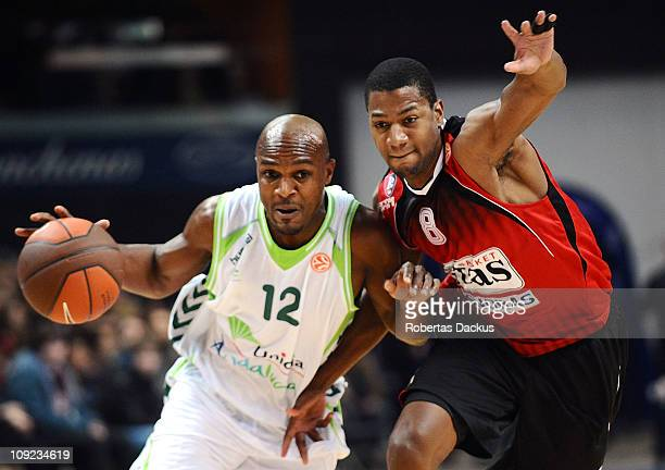Roderick Blakney #12 of Unicaja competes with Darryl Strawberry # 8 Lietuvos Rytas during the 20102011 Turkish Airlines Euroleague Top 16 Date 4 game...
