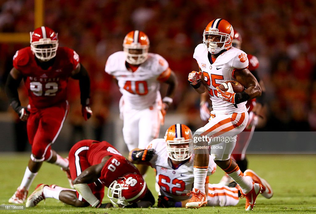 Roderick McDowell #25 of the Clemson Tigers runs with the ball against the defense of the North Carolina State Wolfpack during their game at Carter-Finley Stadium on September 19, 2013 in Raleigh, North Carolina.