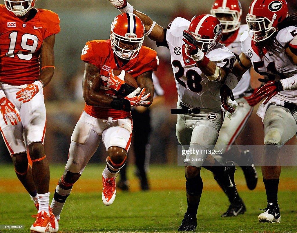 Roderick McDowell #25 of the Clemson Tigers rushes for a first down during the game against the Georgia Bulldogs at Memorial Stadium on August 31, 2013 in Clemson, South Carolina. Clemson defeated Georgia 38-35.