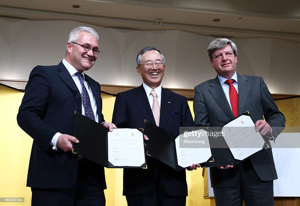 Roderick Munsters, chief executive officer of Robeco Groep NV, from left, Yoshihiko Miyauchi, chairman and chief executive officer of Orix Corp., and Piet Moerland, chairman of Rabobank Groep, pose with signed documents during a news conference in Tokyo, Japan, on Tuesday, Feb. 19, 2013. Orix Corp. agreed to buy Rabobank Groep's asset-management unit for 1.94 billion euros ($2.6 billion) in its largest-ever acquisition. Photographer: Tomohiro Ohsumi/Bloomberg via Getty Images