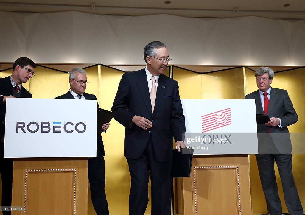 Roderick Munsters, chief executive officer of Robeco Groep NV, from second left to right, Yoshihiko Miyauchi, chairman and chief executive officer of Orix Corp., and Piet Moerland, chairman of Rabobank Groep, walk to a photo session after signing documents during a news conference in Tokyo, Japan, on Tuesday, Feb. 19, 2013. Orix Corp. agreed to buy Rabobank Groep's asset-management unit for 1.94 billion euros ($2.6 billion) in its largest-ever acquisition. Photographer: Tomohiro Ohsumi/Bloomberg via Getty Images