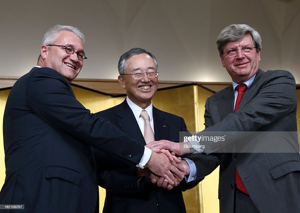 Roderick Munsters, chief executive officer of Robeco Groep NV, from left, Yoshihiko Miyauchi, chairman and chief executive officer of Orix Corp., and Piet Moerland, chairman of Rabobank Groep, shake hands during a news conference in Tokyo, Japan, on Tuesday, Feb. 19, 2013. Orix Corp. agreed to buy Rabobank Groep's asset-management unit for 1.94 billion euros ($2.6 billion) in its largest-ever acquisition. Photographer: Tomohiro Ohsumi/Bloomberg via Getty Images