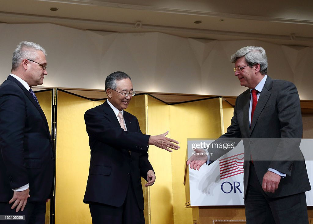Roderick Munsters, chief executive officer of Robeco Groep NV, from left, looks on as Yoshihiko Miyauchi, chairman and chief executive officer of Orix Corp., shakes hands with Piet Moerland, chairman of Rabobank Groep, during a news conference in Tokyo, Japan, on Tuesday, Feb. 19, 2013. Orix Corp. agreed to buy Rabobank Groep's asset-management unit for 1.94 billion euros ($2.6 billion) in its largest-ever acquisition. Photographer: Tomohiro Ohsumi/Bloomberg via Getty Images