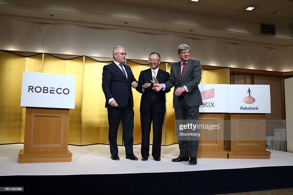 Roderick Munsters, chief executive officer of Robeco Groep NV, from left, Yoshihiko Miyauchi, chairman and chief executive officer of Orix Corp., and Piet Moerland, chairman of Rabobank Groep, pose for photographs during a photo session at a news conference in Tokyo, Japan, on Tuesday, Feb. 19, 2013. Orix Corp. agreed to buy Rabobank Groep's asset-management unit for 1.94 billion euros ($2.6 billion) in its largest-ever acquisition. Photographer: Tomohiro Ohsumi/Bloomberg via Getty Images