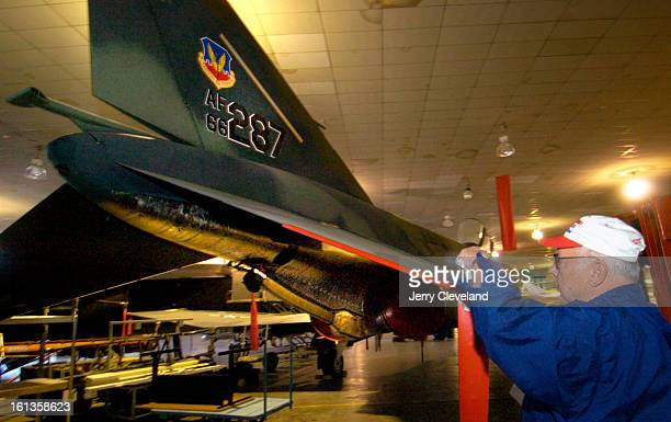 DENVER COLO NOVEMBER 25 2005 Rodger Blum<cq> of Aurora makes a weekly inspection of an F4E Phantom II<cq> fighter in the Wings Over The Rockies Air...