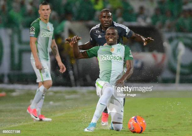 Rodin Quiñones of Atletico Nacional fights for the ball with Eliser Quiñonez of Millonarios during the semi finals second leg match between Atletico...