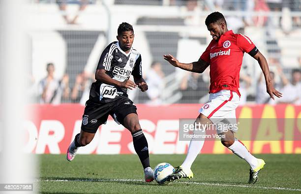 Rodinei of Ponte Preta fights for the ball with Geferson of Internacional during the match between Ponte Preta and Internacional for the Brazilian...