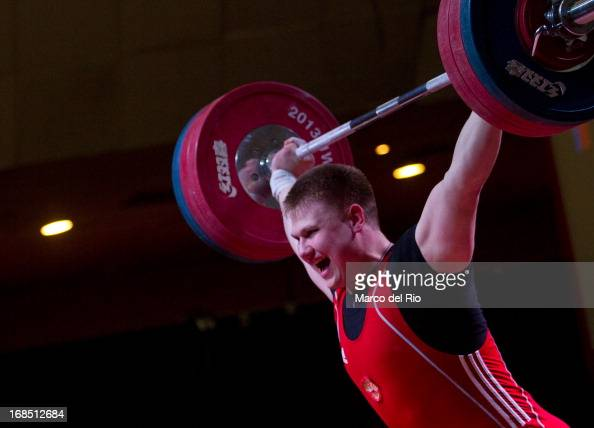 Rodion Bochkov of Russia A competes in Men's 105kg during day seven of the 2013 Junior Weightlifting World Championship at Maria Angola Convention...