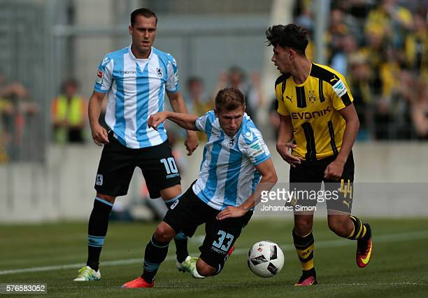 Rodnei and Levent Aycicek of Muenchen fights for the ball with Dario Scuderi of Dortmund during the friendly match between TSV 1860 Muenchen and BVB...