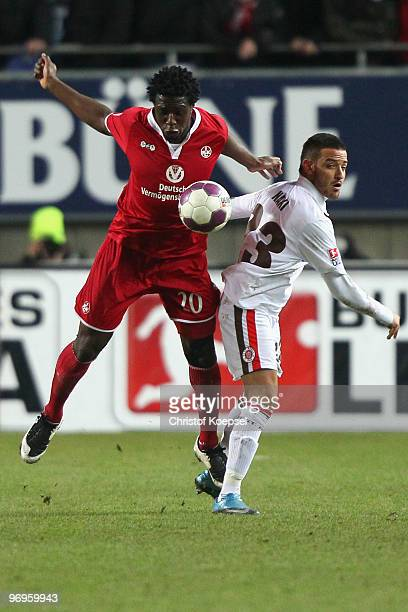 Rodnei of Kaiserslautern and Deniz Naki of St Pauli go up for a header during the Second Bundesliga match between 1FC Kaiserslautern and FC St Pauli...