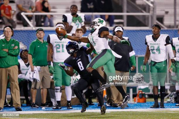 Rodney Allen of the Marshall Thundering Herd defends a pass intended for Ty Lee of the Middle Tennessee Blue Raiders in the second quarter of a game...