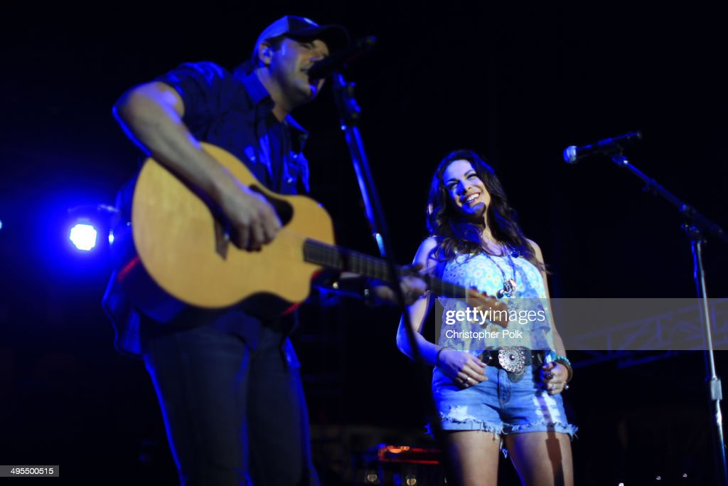 Rodney Atkins and wife Rose Falcon perform during Rodney Atkins 4th Annual Music City Gives Back on June 3, 2014 in Nashville, Tennessee.