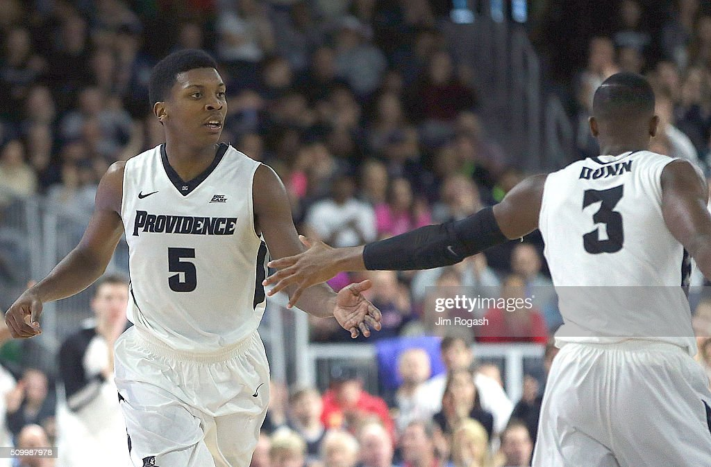 Rodney Bullock #5 of the Providence Friar celebrates with <a gi-track='captionPersonalityLinkClicked' href=/galleries/search?phrase=Kris+Dunn&family=editorial&specificpeople=7887137 ng-click='$event.stopPropagation()'>Kris Dunn</a> #3 against the Georgetown Hoyas in the second half on February 13, 2016, at the Dunkin' Donuts Center in Providence, Rhode Island.