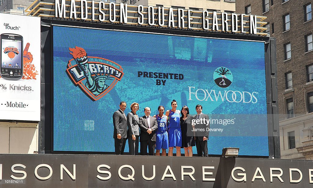 Rodney Butler, Carol Blazejowski, Rob Victoria, Cappie Poindexter, Janel McCarville, Donna Orender and Scott O'Neil pose for photos atop the Madison Square Garden marquee to promote new partnership between NY Liberty and Foxwoods at Madison Square Garden on June 2, 2010 in New York City.