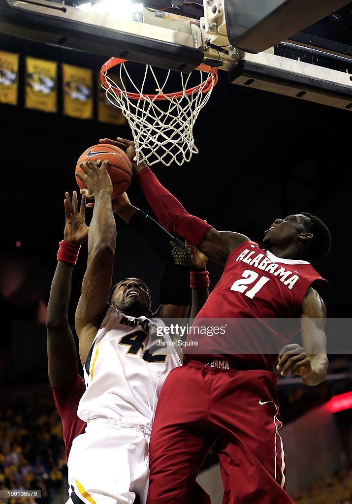 Rodney Cooper #21 of the Alabama Crimson Tide blocks a shot by Alex Oriakhi #42 of the Missouri Tigers during the game at Mizzou Arena on January 8, 2013 in Columbia, Missouri.