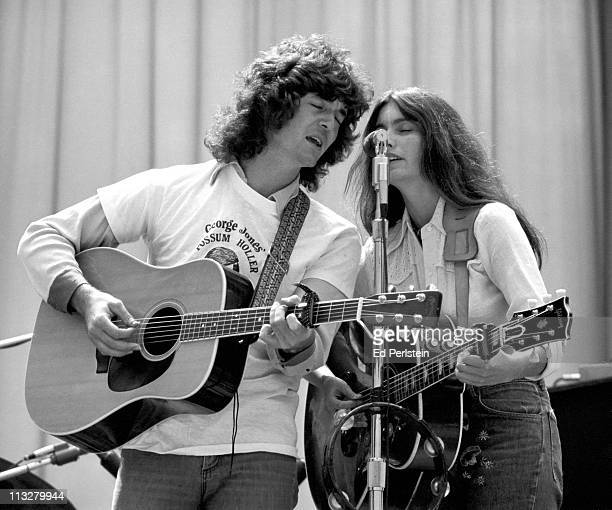 Rodney Crowell and Emmylou Harris perform with the Hot Band at the Greek Theater on August 16 1975 in Berkeley California