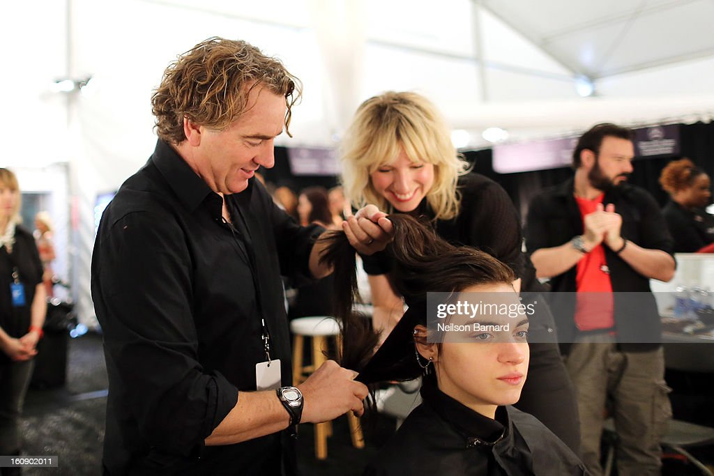 Rodney Cutler, Redken Expert And Celebrity Runway Stylist For THE SALON At Ulta Beauty Backstage styles models hair at The Tadashi Shoji Fall 2013 Show on February 7, 2013 in New York City.