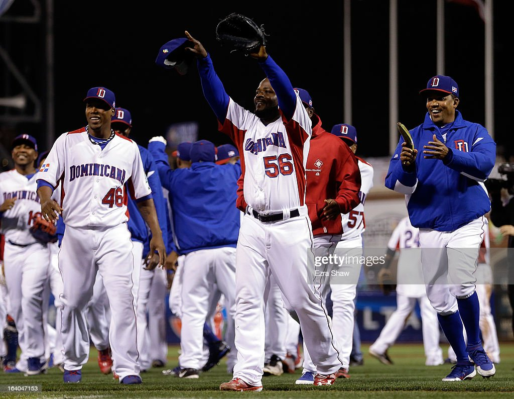Rodney Fernando #56 of the Dominican Republic celebrates with his team after defeating the Netherlands to win the semifinal of the World Baseball Classic at AT&T Park on March 18, 2013 in San Francisco, California.