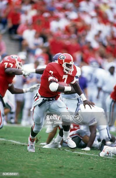 Rodney Hampton of the Georgia Bulldogs runs with the ball during an NCAA game circa 1989 at Sanford Stadium in Athens Georgia