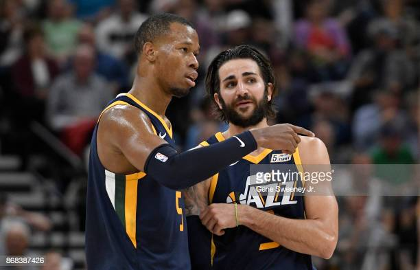 Rodney Hood and Ricky Rubio of the Utah Jazz talk during a second half time out during their 10489 win over the Dallas Mavericks at Vivint Smart Home...