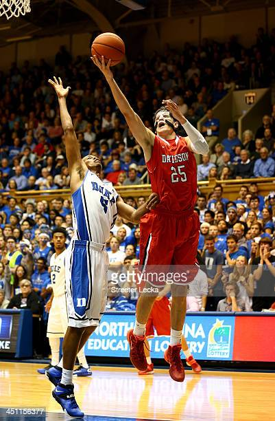 Rodney Hood of the Duke Blue Devils guards Jake Belford of the Davidson Wildcats during their game at Cameron Indoor Stadium on November 8 2013 in...
