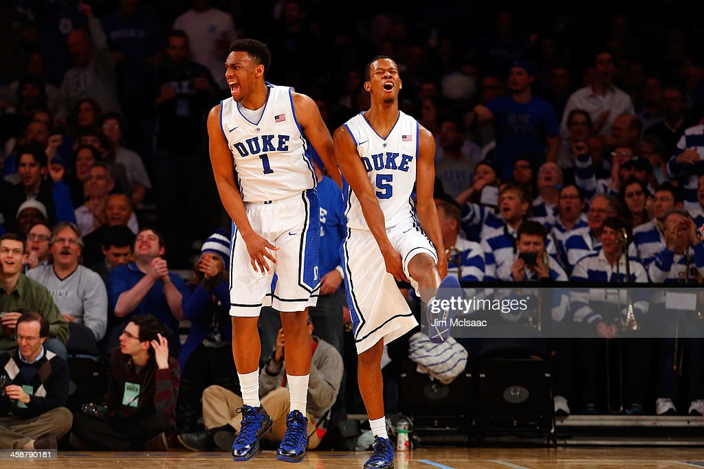 Rodney Hood #5 of the Duke Blue Devils reacts with teammate Jabari Parker #1 after his basket was disallowed in the second half against the UCLA Bruins during the CARQUEST Auto Parts Classic on December 19, 2013 at Madison Square Garden in New York City.