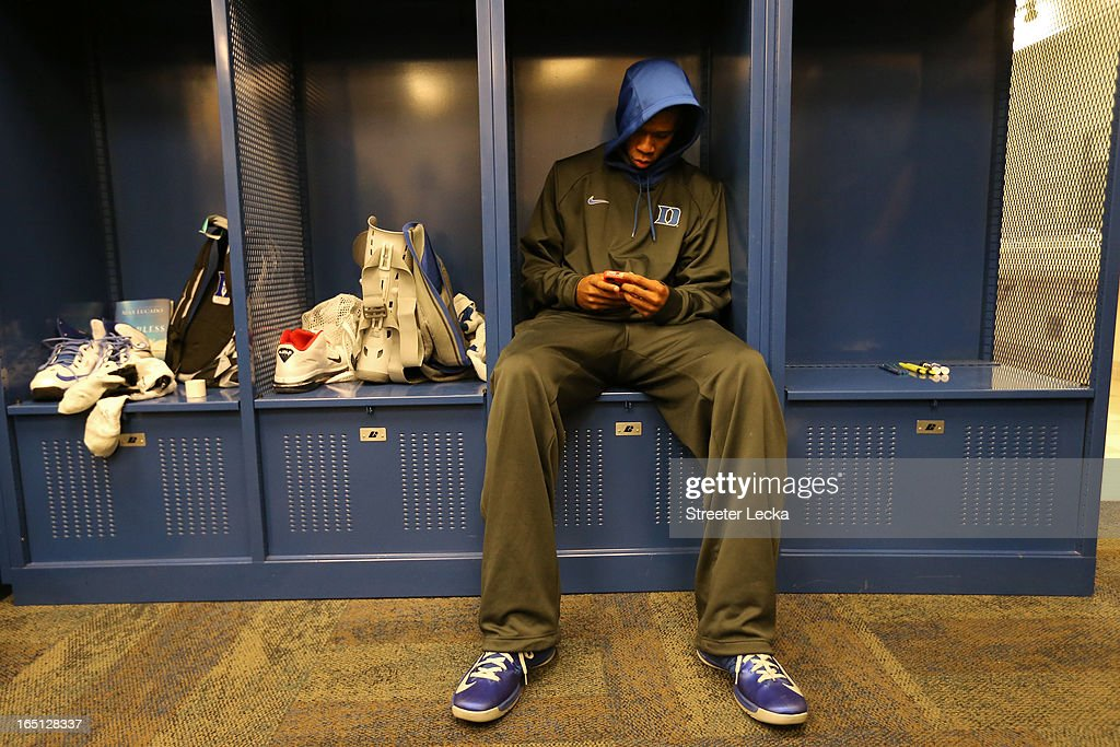 Rodney Hood of the Duke Blue Devils sits dejected in the locker room after they lost 85-63 against the Louisville Cardinals during the Midwest Regional Final round of the 2013 NCAA Men's Basketball Tournament at Lucas Oil Stadium on March 31, 2013 in Indianapolis, Indiana.