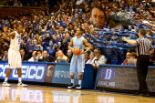Rodney Hood of the Duke Blue Devils watches as JP Tokoto of the North Carolina Tar Heels throws the ball in during their game at Cameron Indoor...