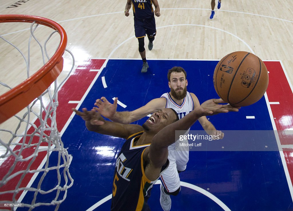 Rodney Hood #5 of the Utah Jazz attempts a shot against Sergio Rodriguez #14 of the Philadelphia 76ers in the first half at Wells Fargo Center on November 7, 2016 in Philadelphia, Pennsylvania. The Jazz defeated the 76ers 109-84.