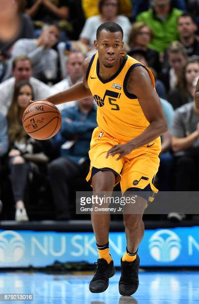 Rodney Hood of the Utah Jazz brings the ball up court against the Milwaukee Bucks in the first half at Vivint Smart Home Arena on November 25 2017 in...