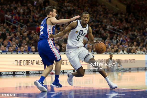 Rodney Hood of the Utah Jazz drives to the basket against TJ McConnell of the Philadelphia 76ers in the first quarter at the Wells Fargo Center on...