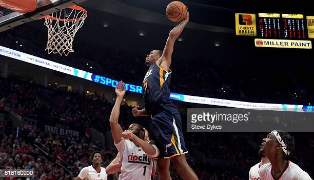 Rodney Hood of the Utah Jazz goes up for a dunk on Evan Turner of the Portland Trail Blazers in the third quarter of an NBA game at the Moda Center...