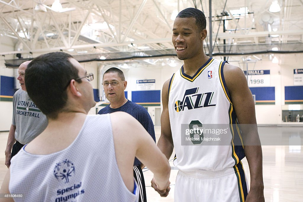 Rodney Hood #6 of the Utah Jazz shakes hands with young fan at a special Olympics event at the Zions Basketball Center on June 28, 2014 in Salt Lake City, Utah.