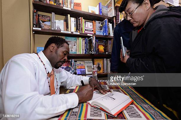 Rodney King autographs copies of his new book 'The Riot Within My Journey From Rebellion to Redemption' at EsoWon booksstore on April 30 2012 in Los...