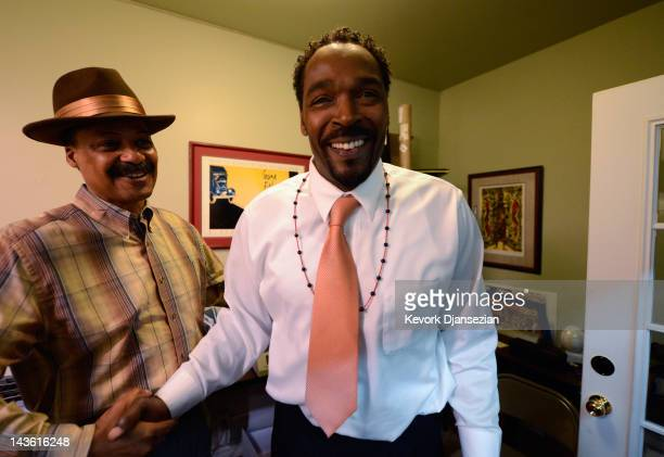 Rodney King is greeted by Firpo Carr as he arrives at EsoWon bookstore to sign copies of his new book 'The Riot Within My Journey From Rebellion to...