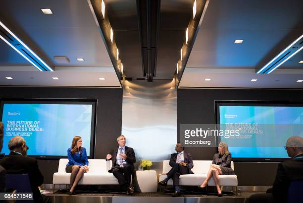Rodney Lawrence global head of international tax services for KPMG LLP second left and Kristi Kuechler president of FOX Private Investor Center right...