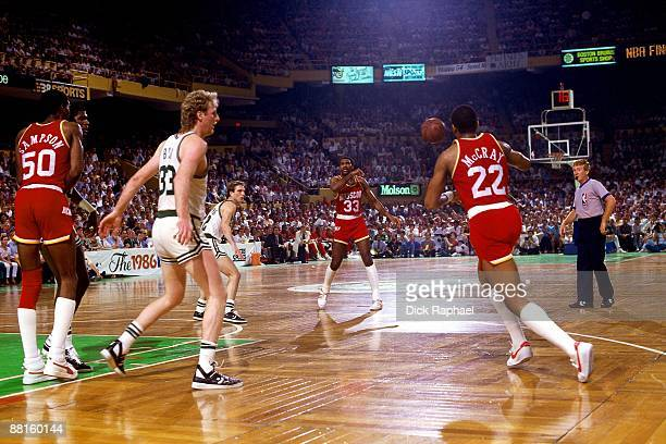Rodney McCray of the Houston Rockets receives the pass against Larry Bird of the Boston Celtics in Game Six of the 1986 NBA Finals at the Boston...