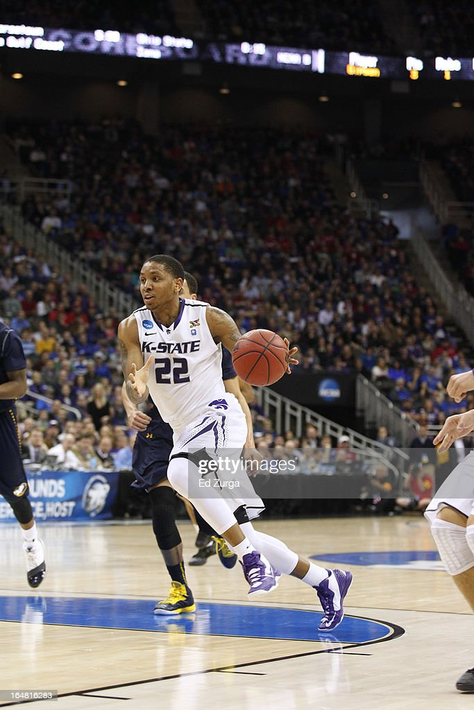 <a gi-track='captionPersonalityLinkClicked' href=/galleries/search?phrase=Rodney+McGruder&family=editorial&specificpeople=6572093 ng-click='$event.stopPropagation()'>Rodney McGruder</a> #22 of the Kansas State Wildcats drives to the basket against against the La Salle Explorers during the second round of the 2013 NCAA Men's Basketball Tournament at the Sprint Center on March 22, 2013 in Kansas City, Missouri.