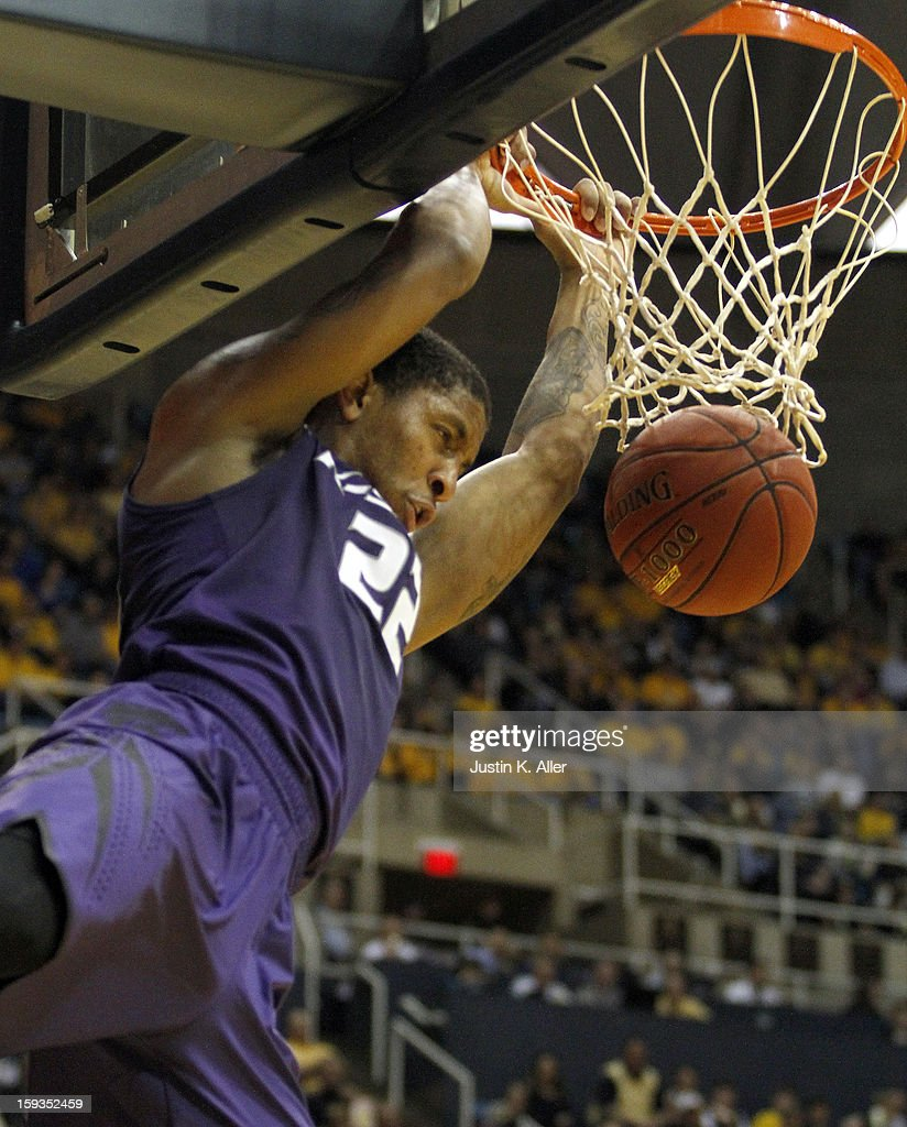 Rodney McGruder #22 of the Kansas State Wildcats dunks the ball against the West Virginia Mountaineers during the game at at the WVU Coliseum on January 12, 2013 in Morgantown, West Virginia.