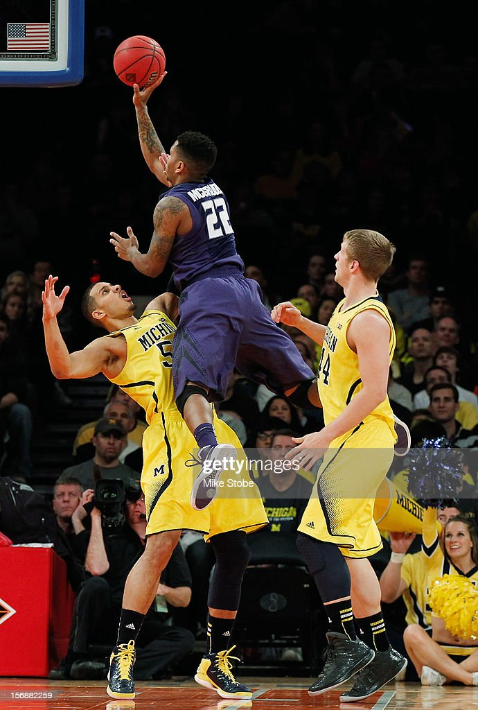 Rodney McGruder #22 of the Kansas State Wildcats hits a basket over the top of Eso Akunne #5 of the Michigan Wolverines at Madison Square Garden on November 23, 2012 in New York City. Michigan Wolverines defeated Kansas State Wildcats 71-57.