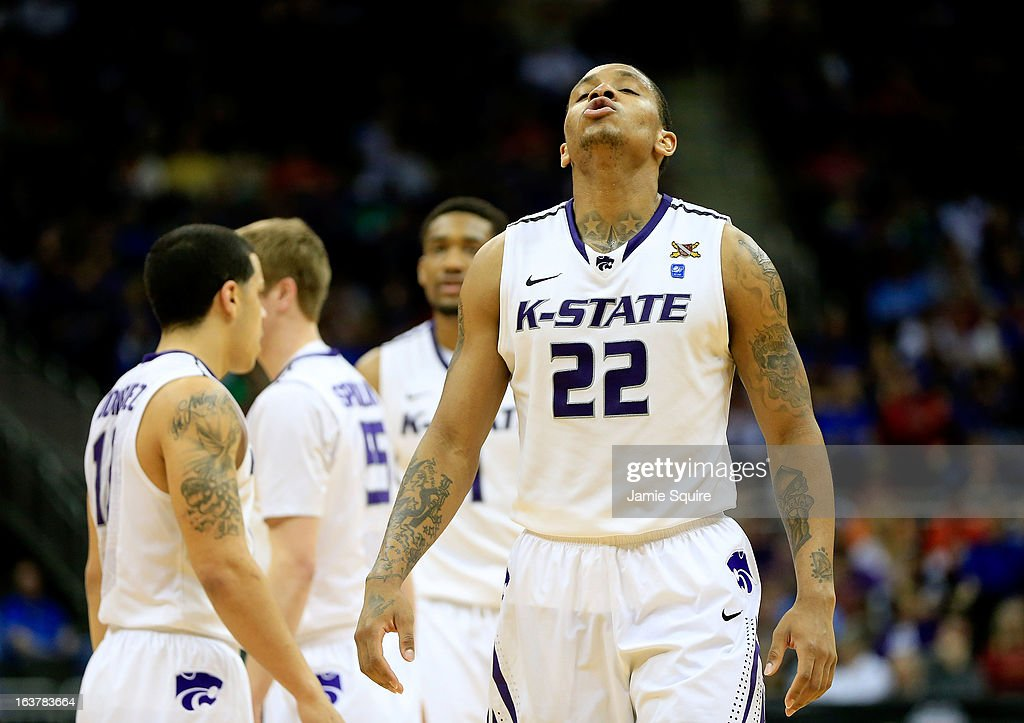 Rodney McGruder #22 of the Kansas State Wildcats reacts after scoring against the Oklahoma State Cowboys in the second half during the Semifinals of the Big 12 basketball tournament at the Sprint Center on March 15, 2013 in Kansas City, Missouri.